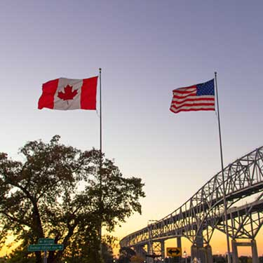trust-canada-cross-border-freight-with-r+l-global-logistics-flags
